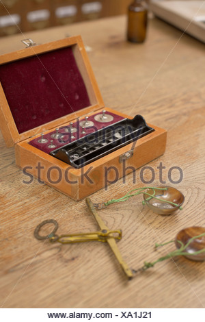 An old-fashioned scale and a box with weights - Stock Photo