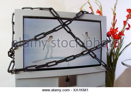 Fernseher in Ketten - Stock Photo