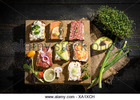 Various garnished sandwiches - Stock Photo