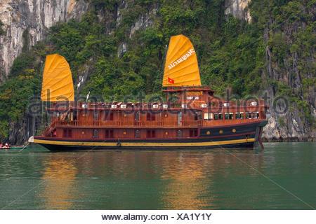 Asia boat bay junk yellow water wooden Halong wood wooden boat coast South-East Asia ship sailing ship traditionally Vietna - Stock Photo