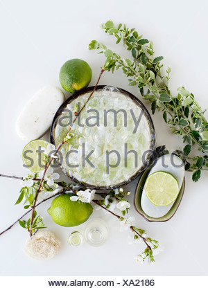Aromatic still life with limes, blossom and soap - Stock Photo