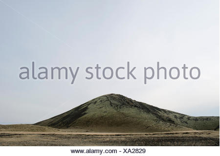 lava fields and hill, route 574, Neshraun, Saxholar, Snaefellsnes, West Iceland - Stock Photo