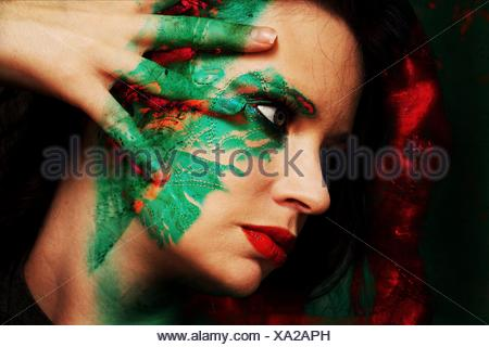Close-Up Of Beautiful Woman With Face Paint - Stock Photo
