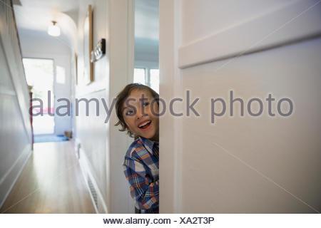 Excited boy in doorway - Stock Photo