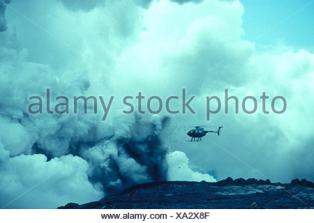 Helicopter over volcano eruption. - Stock Photo