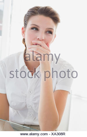 Business woman looking very tired - Stock Photo