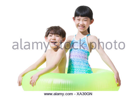 Cute children in swimsuit with swim ring - Stock Photo