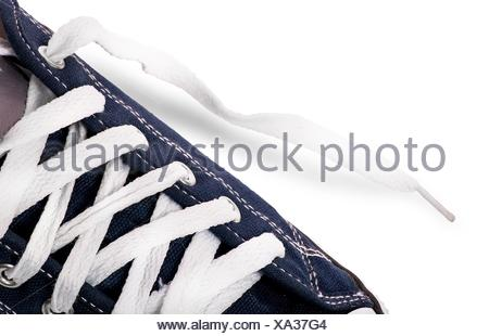 Closeup lacing on athletic shoes isolated on white background. - Stock Photo