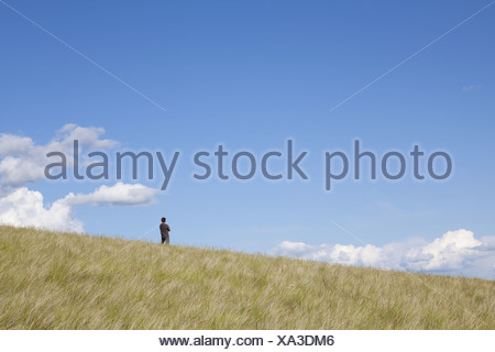Washington USA man standing on the crest of hill - Stock Photo