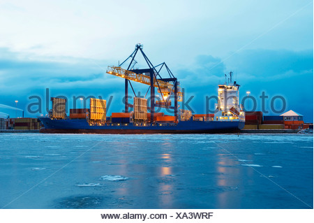 Containers on ship in harbour - Stock Photo
