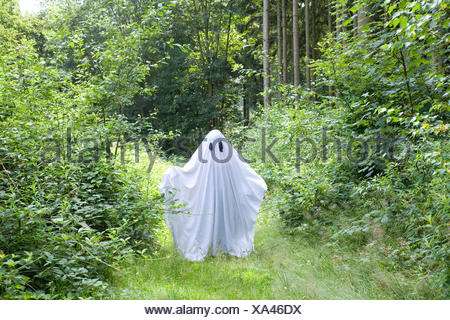 a white ghost in forest - Stock Photo