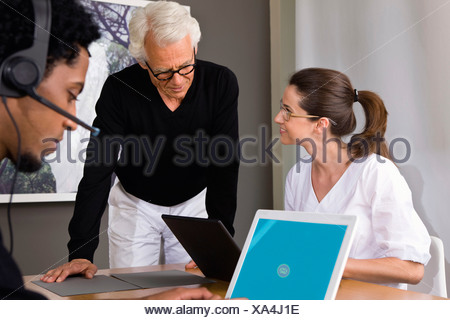 Businesspeople working on laptops - Stock Photo