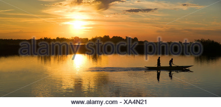 Sunset in Cavallino Harbour, fishing boat, view of lagoon, Venice, Italy - Stock Photo