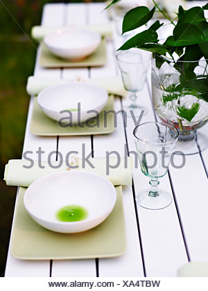 A laid table outdoors, Sweden. - Stock Photo