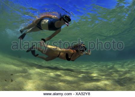 Mother & daughter snorkeling, Haena, Kauai - Stock Photo