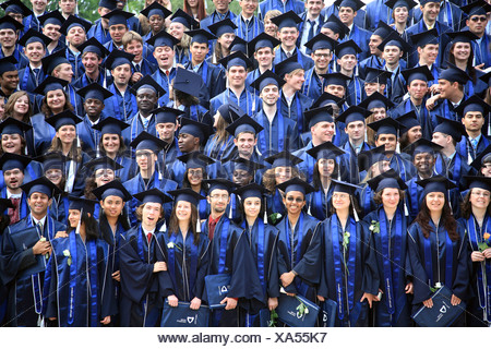 Students posing to an offical graduation photo at Jacobs University in Bremen, Germany - Stock Photo