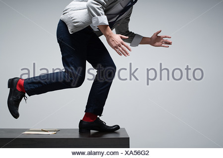 An office worker running on a desk - Stock Photo