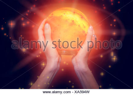 Composite image of fortune teller holding crystal ball - Stock Photo