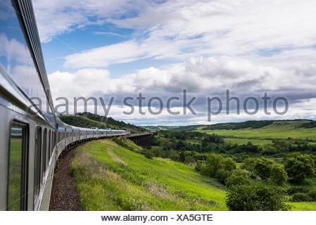 Passenger train going over the Uno trestle bridge in Manitoba, Canada - Stock Photo