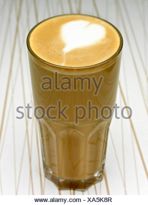 Close-up of a café au lait on designed background - Stock Photo