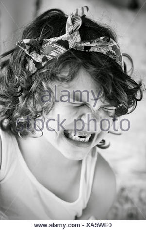 Portrait of a girl pulling funny faces - Stock Photo