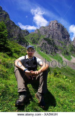 rambler climber put sitting sit facilitate ease resting relax recover relaxing - Stock Photo