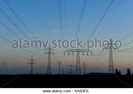 several high-tension power lines in front of evening sky, - Stock Photo