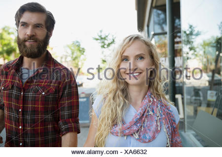 Portrait smiling couple outside storefront - Stock Photo