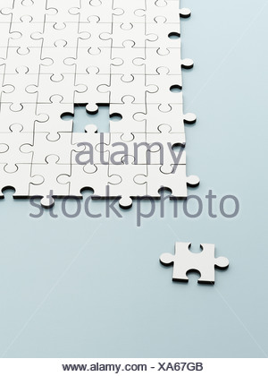 Missing jigsaw piece - Stock Photo