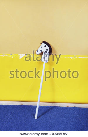Hobbyhorse leaning against a wall, - Stock Photo