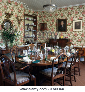 Floral Wallpaper In Formal Dining Room With Place Settings On The Table    Stock Photo