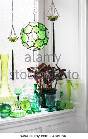 Green ornaments on a windowsill Sweden - Stock Photo