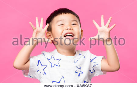Excited little boy showing grimace - Stock Photo