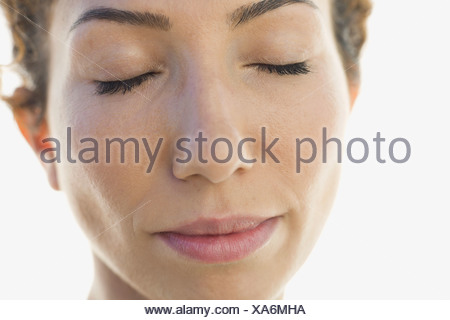 Close-up portrait of woman with eyes closed - Stock Photo