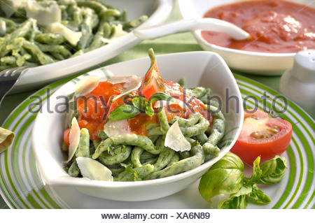 Spinach Noodles with Tomato Purée - Stock Photo