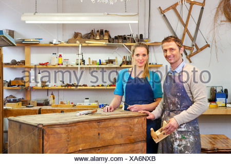 Carpenters working on wooden drawers - Stock Photo