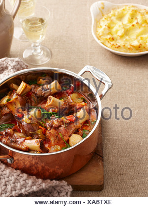 Dish of braised lamb and vegetables - Stock Photo