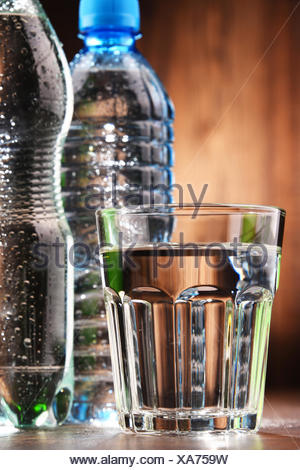 Composition with glass and bottles of mineral water - Stock Photo