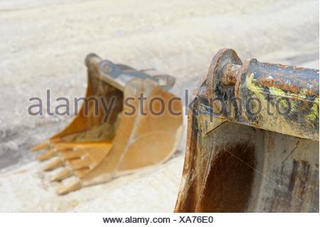 Excavator bucket on a construction site - Stock Photo