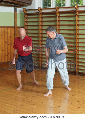 Men working out together in gym - Stock Photo