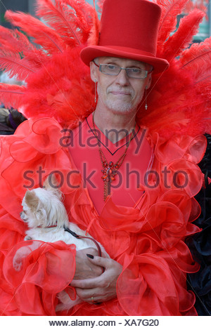 Mature man in scene clothes with dog, Wave-Gotik-Treffen, Leipzig, Saxony, Germany - Stock Photo