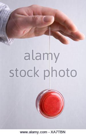 A human hand yo-yoing - Stock Photo