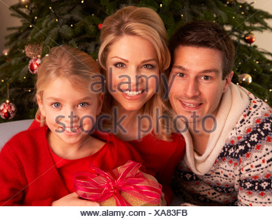 Family Opening Christmas Gifts At Home - Stock Photo