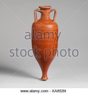 Terracotta amphora (storage jar). Period: Early Imperial; Date: 1st century A.D; Culture: Roman; Medium: Terracotta; red-glaze; Dimensions: 10 - Stock Photo