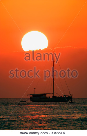 Boat silhouetted against sky - Stock Photo