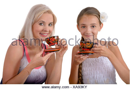 Mother and daughter drinking tea - Stock Photo