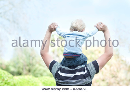 Father with baby son on shoulders - Stock Photo