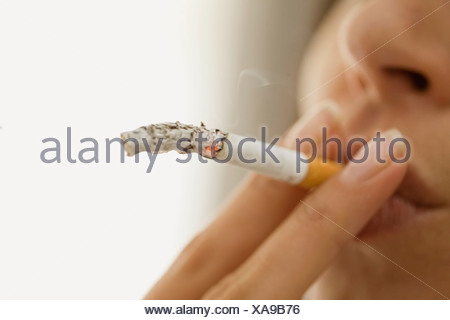 Close up of woman smoking cigarette - Stock Photo