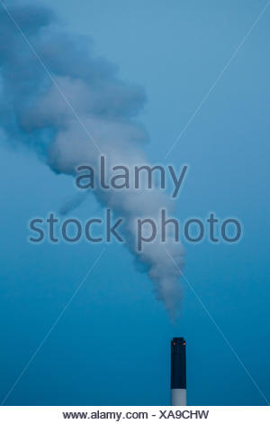 Low Angle View Of Smoke Emitting From Industry Against Sky - Stock Photo