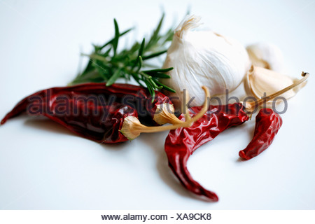 Chili peppers and garlic over white background - Stock Photo
